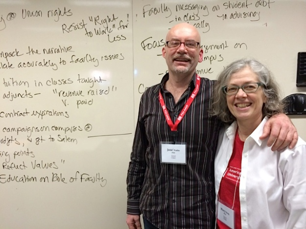 outgoing AAUP president Mary King and incoming president José Padín